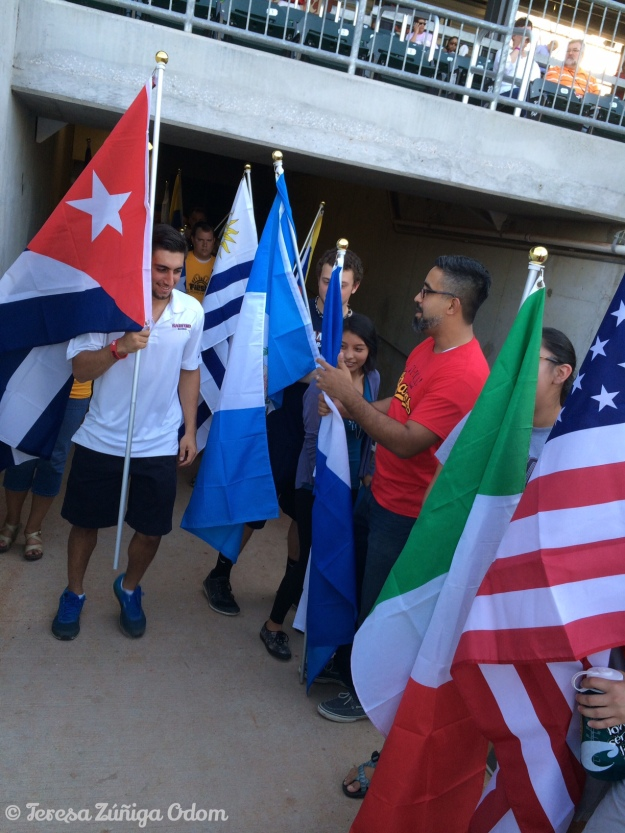 Carlos and the students get ready to show off the flags of Latin countries.