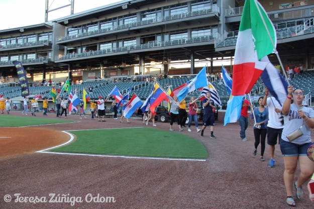 Samford Students participated in the Parade of Latino Country Flags before the beginning of the game.