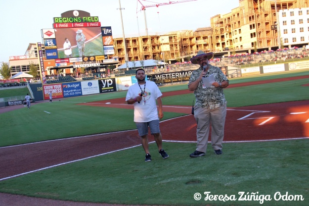 Fiesta board member, Orlando Rosa helps Don Leo of The Barons open up the game festivities in Spanish!