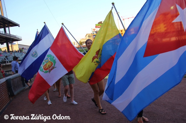 Students from Samford University Latin American Studies take to Regions Field for the parade of Latin American flags at Fiesta Night with Los Barons on August 27.