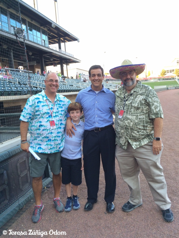 Mike Suco, one of Fiesta's founding board members poses with his son Mikey, and Barons Staff Members John Cook and Don Leo.