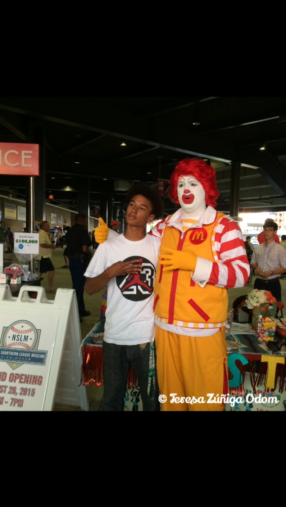 One of the many photos Ronald McDonald took with Barons Baseball game attendees.