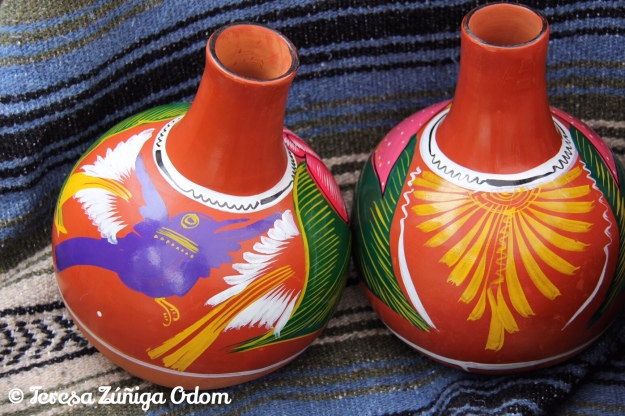 Jarrito jars at the Mexico booth.  This is the type of clay jar that Maria and Luis gave to me at Fiesta.  So beautiful!!!