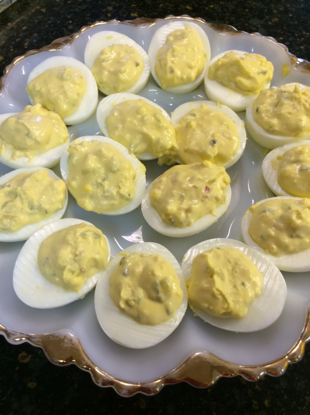 Deviled eggs...a little mayo, mustard and sweet pickle relish.  Delish!
