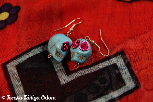 Turqoise calavera earrings with fuchsia floral eyes...found at Charming Charlie.