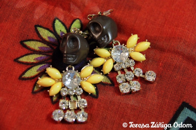 Brown sugar skull with rhinestone and yellow accents....makes the sugar skull look like he can fly!