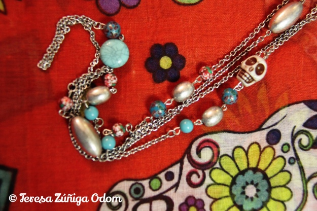Long sugar skull necklace with cloisonné beads, and silver beads.