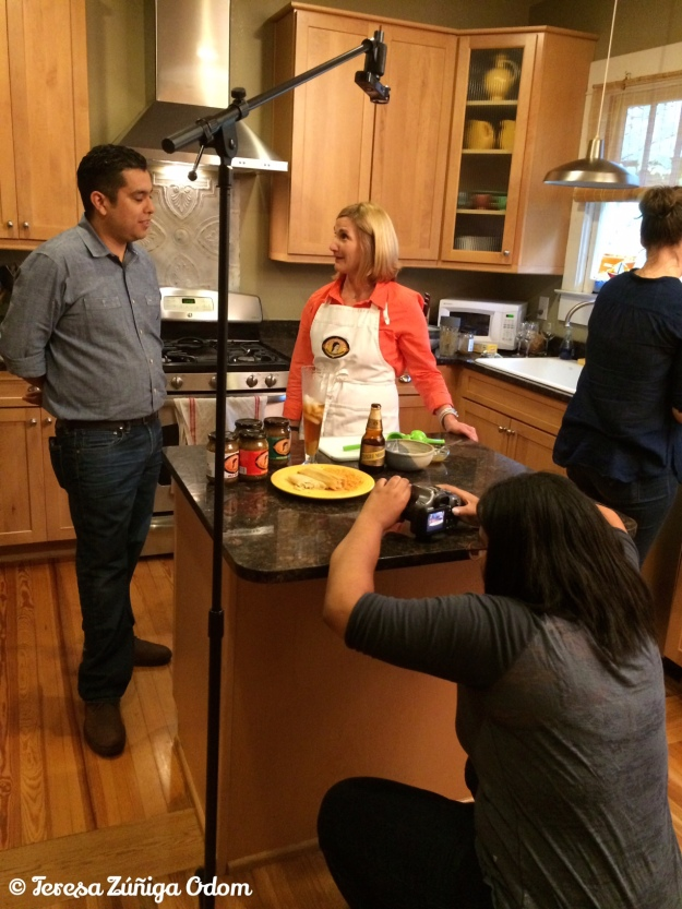 UAB Film Making Graduate - Jessica Chriesman - works the angles during the tamale sale videos. This one features Lori Sours, co-creator of Salsa Senorita and Ernesto Martinez of Hacienda Grill.