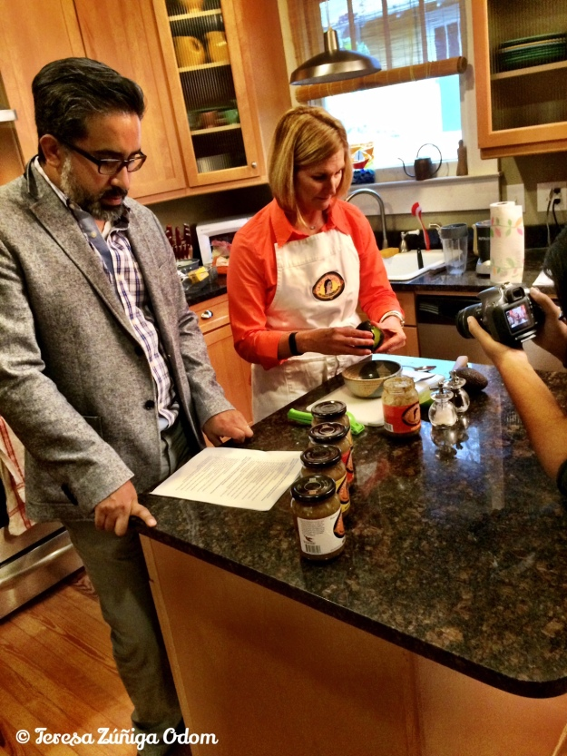 Carlos Aleman studies his lines as Lori Sours sets up for their guacamole segment of the HICA tamale sale videos.