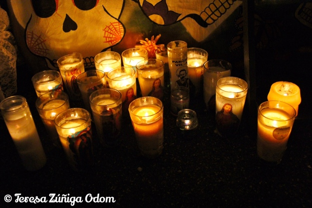 Candles light one of the altars at Day of the Dead #13
