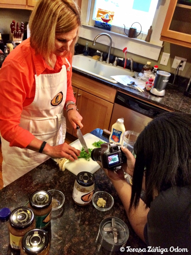 Lori works on the slaw ingredients while Jessica Chriesman does some filming.