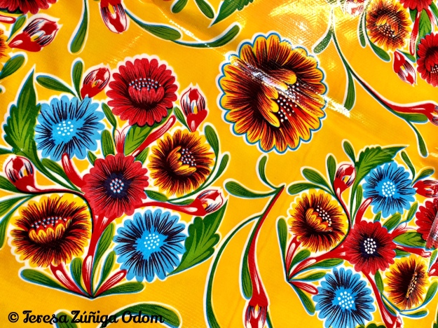 Yellow bloom oilcloth vinyl tablecloth my mother bought in New Mexico several years ago.