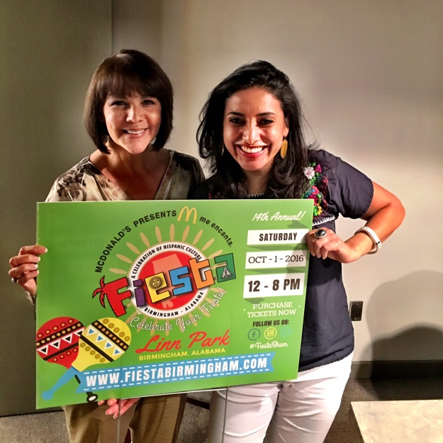 Me and Fiesta Board President - Cristina Almanza - after our last board meeting this week holding one of our Fiesta yard signs. I love seeing these all over Birmingham leading up to the event each year!