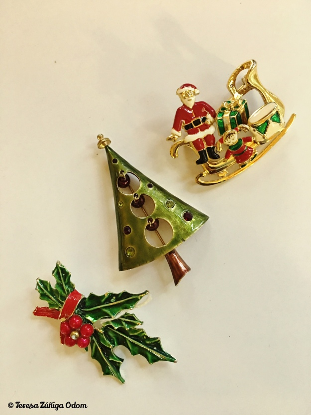 These pins have no marking that I could find. The Santa in the sleigh moves along with the other pieces attached. Pretty unique!