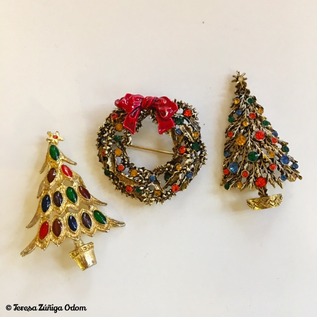 The wreath and tree on the right are ART(c) marked and considered very collectible Christmas pieces! I love the colors on the tree to the left - no markings on this pin but very art deco looking.