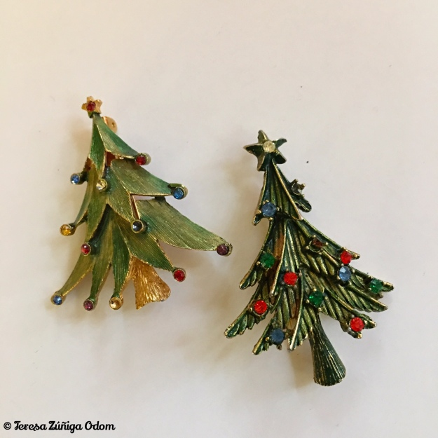 The tree pin on the left is a JJ(c) Jonette Jewelry Company piece. The tree on the right has no markings.