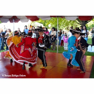 Hispanic children dance at the Cultural Village stage in traditional Mexican costumes. (Fiesta 2006)
