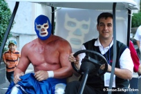 Mike Suco, of Coca Cola Bottling and Fiesta Board Member escorts Blue Demon around Fiesta in 2007