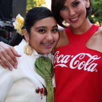 Gabriella and a young Mariachi girl from Texas post for a photo.