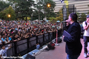 Fiesta board member, Orlando Rosa, speaks to the crowd before the major acts of the evening perform.