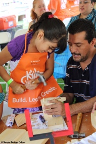 A father and daughter enjoy the Fiesta Family Village activities provided by Home Depot