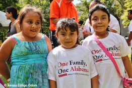 Little girls pose for a picture in the nonprofit village