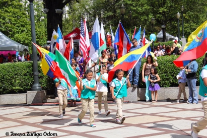 Hispanic Girl Scouts of North Central Alabama lead the festival in the parade of flags.