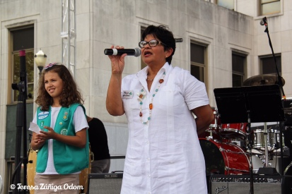 Maricela Mendez, of Girl Scouts of North Central Alabama speaks from the main stage about Girl Scouting.