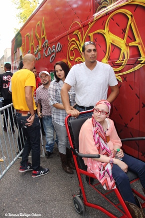 Jazmine is wheeled to El Dasa's trailer by her father and followed by her mother. Amado Santos from Children's Hospital is behing her and helped arranged for this meeting.