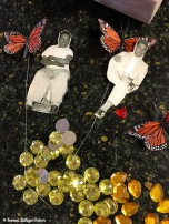 Separated plastic gemstones to use in the retablo.