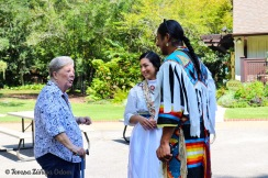 Mom chats with two of the pow wow dancers