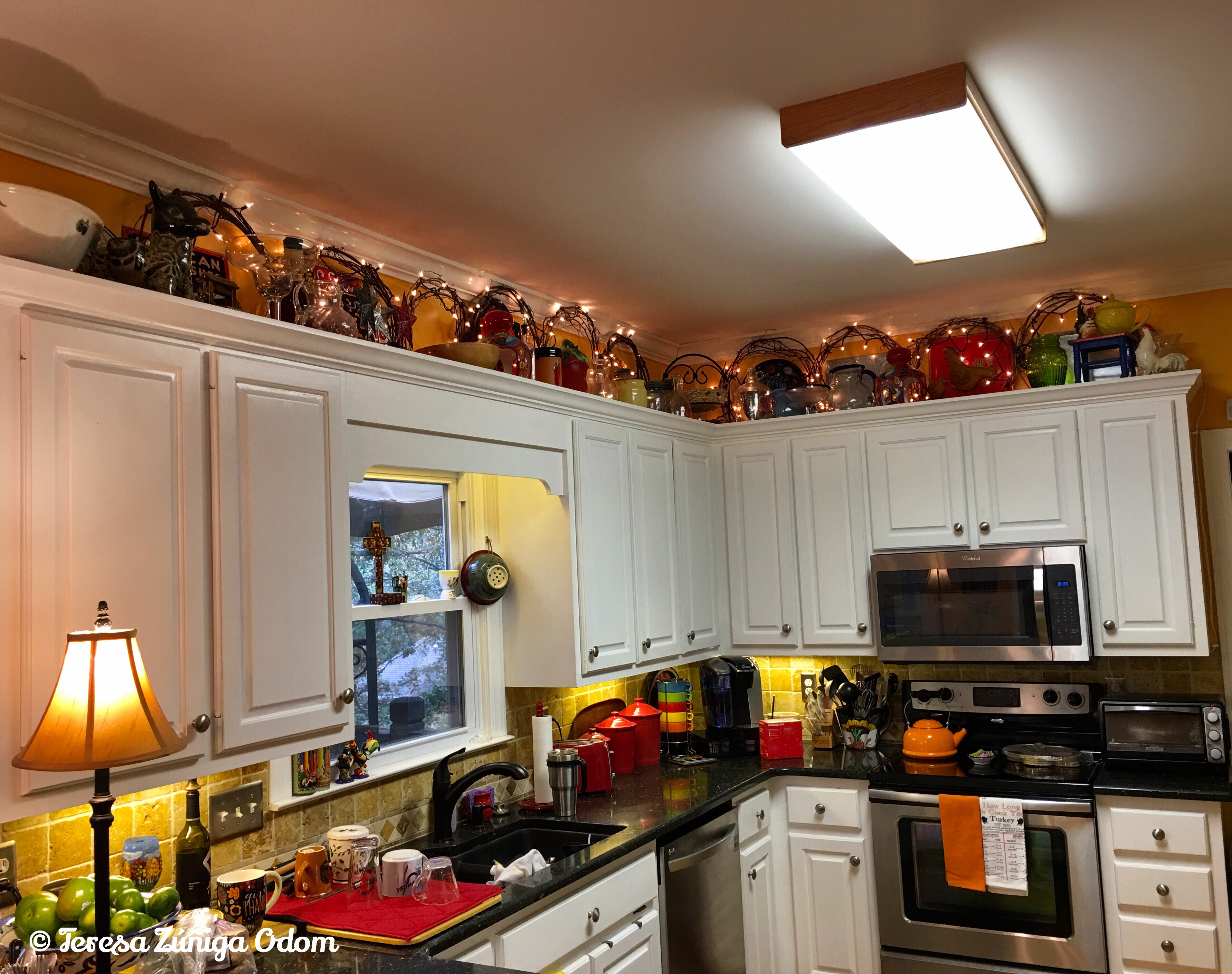 That Awkward Space Above Your Kitchen Cabinets