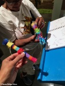 Signing the visitors book with piñata pens.