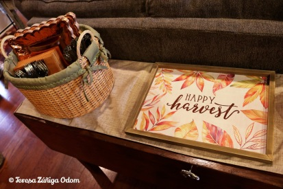 Thanksgiving plates and napkins set up beside the sofa couch with a sweet Happy Harvest Tray