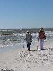 Johnny and Joyce take a walk on the beach.