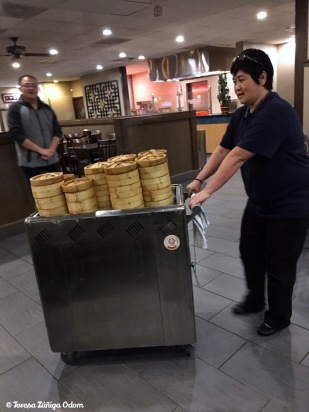 The Black Pearl owne, Michelle Mei, rolls out the dim sum cart.