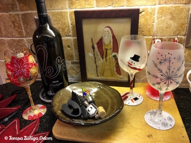 My wine nook in the kitchen - the framed Santa is a thrift store find along with the 3 Lolita wine glasses on the right.