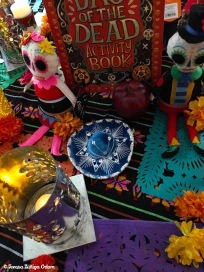 The centerpiece of the dining room is this Day of the Dead activity book - a gift from a friend...along with two sugar skull dolls I found at Target this year. They are so adorable. In the foreground...a punched tin Mexican lantern. I found 3 at the thrift store just a few days before Dia de los Muertos...a sign, perhaps?!