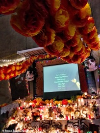 Memorial altar - names of loved ones who have passed on scroll on a powerpoint