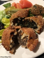 Fatayer - fried dough stuffed with spinach and beef along with onions,, pine nuts and seasoning.