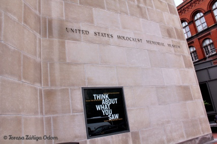 "Outside the museum...a reminder - ""think about what you saw."""