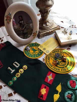 My junior sash with badges along with other Girl Scout memorabilia when I was a Girl Scout in Puerto Rico.