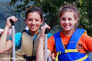 My older daughter, Anna Marie and her friend Leslie working at Camp KPC summer camp while in middle school.