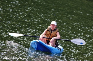 My younger daughter, Emily, working at Girl scout summer camp in Shelby County while in high school.