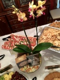 An orchid decorated the dining room table along with my parent's wedding photo