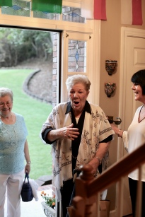 Mom realizing she was having a surprise party last year on her 80th birthday!