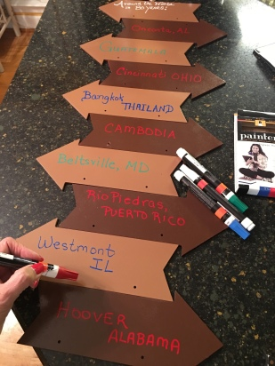 Lining up the directional arrows and writing the places mom has lived...