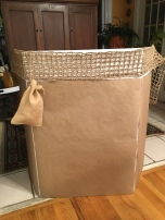 Wrapped in brown paper and using burlap to create a hot air balloon basket