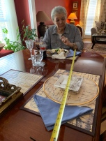 We sat mom at one end of the dining room table to eat lunch and we were at the other end.