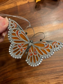 This butterfly is going to look beautiful against the Christmas tree lights